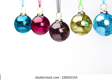 Five ornaments dangle in mid-air against a white background.