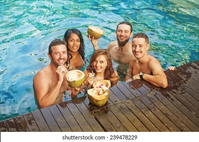 five people having party in the pool