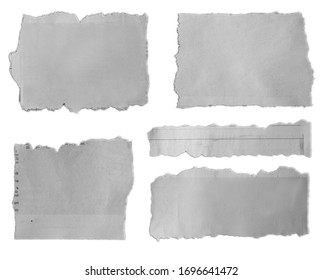 Five pieces of torn paper on plain background
