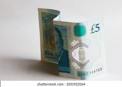 Five pound banknote on a white background.