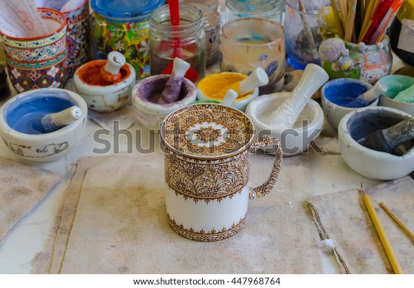 The Five Primary Color of glass (Benjarong: a  traditional five-coloured Thai ceramics) on the working table. Selective Focus.