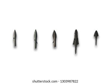 Five primitive bronze arrowheads. Isolated over white background