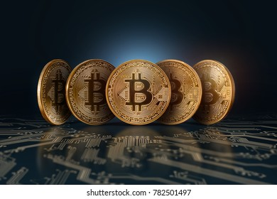Five real Bitcoins coins on a dark background lined up on a digital board. Electronic money, crypto currency.