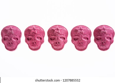 Five Red Army Skull, Ecstasy, MDMA or medication pills shaped like a skull isolated on a white background.