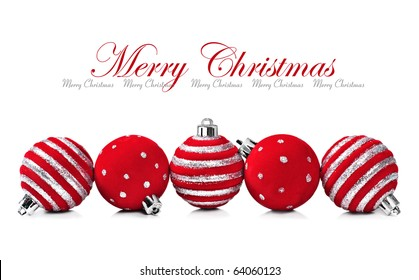 Five red christmas decoration ball on a white background with space for text