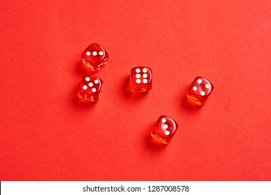 five red dice view from above on red background