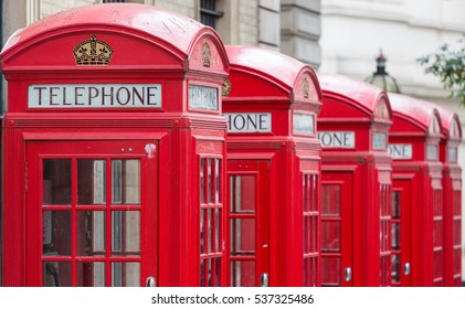 Five Red London Telephone boxes all in a row in the City
