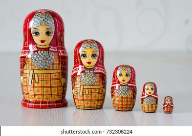 Five red matryoshka. Blurred background. Close-up