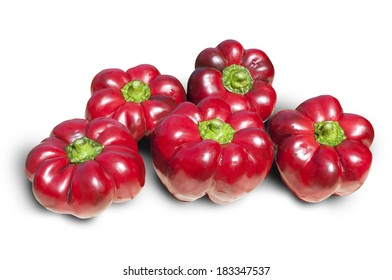 Five red paprika on white background