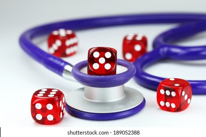 Five red translucent dice with white spots on them front of a purple stethoscope, asking the question do you gamble with your health?