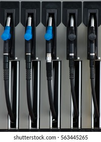 Five refueling nozzles on gas station.