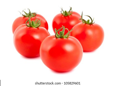 Five ripe red tomatoes isolated on white background