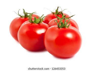 Five ripe tomatoes isolated on white background