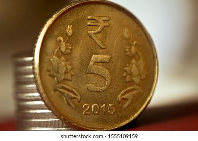 five rupees coin in gold color