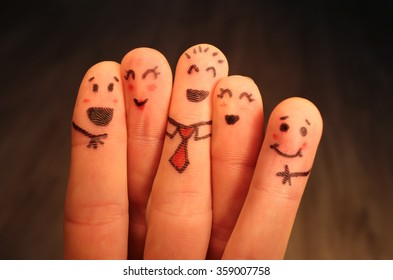 Five school friends finger puppets hugging and having fun together.