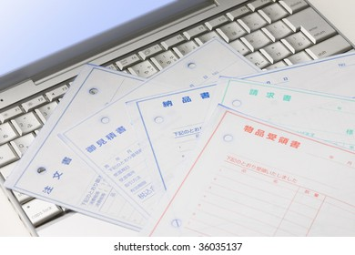 Five sheets of documents on the laptop PC keyboard