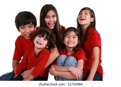 Five siblings with red shirts isolated on white