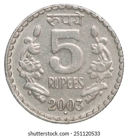Five silver Indian rupees on a white background