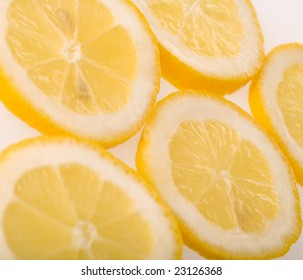 Five slices of lemon isolated on white background