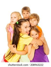 Five smiling hugging kids