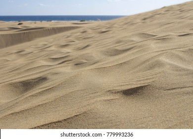 Five square kilometres of protected sand dunes at Maspalomas, Gran Canaria, create a beautiful natural phenomenon and massive tourist attraction.