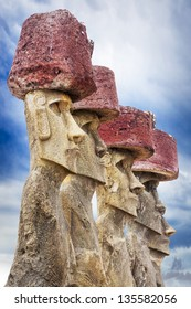 Five standing moai with red hats in Easter Island