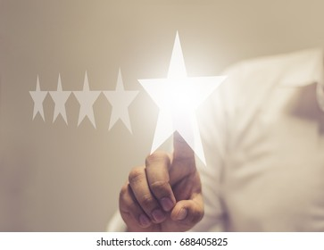 Five stars (5) rating with a businessman touching screen, concept about positive customer feedback and review, excellent performance / soft focus picture / Vintage concept