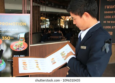 The five stars hotel's staffs are practicing how to serve customers at the hotel's pool side, Pattaya - Thailand, 22 May 2018