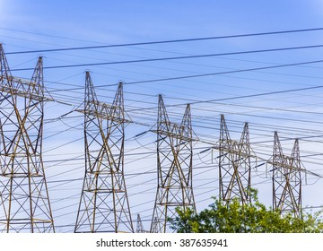 Five steel hydro towers support power cables carrying high voltage electricity from the generating plant in Niagara Falls Canada.
