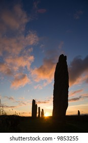 Five stones of the Ring of Brodgar in Orkney at sunset