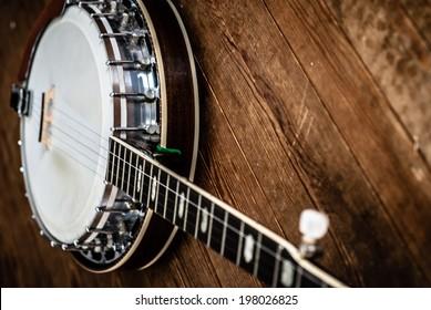 Five String Banjo on a hardwood floor.