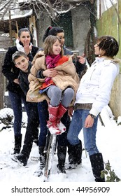 five teenagers playing with flakes and bicycle