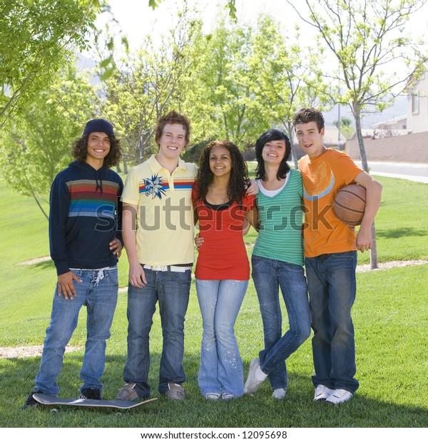 Five teens hang out at park