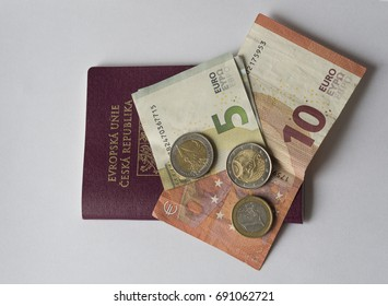five and ten euros bank bill and two and one euro coin on EU passport - travel europe