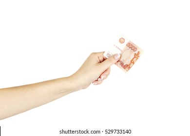 Five thousand roubles in isolated female hand on a white background.