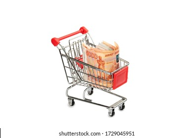 Five thousand Russian rubles bills in a small shopping cart isolated on a white background