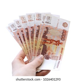 Five thousand russian rubles in hand isolated on white background. Bundle of banknotes of 5000 rubles of the Russian Federation.