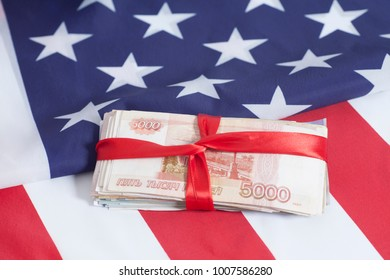 Five thousands rubles on American flag background closeup.