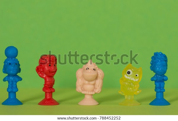 Christmas Cracker Toys.Five Tiny Christmas Cracker Toys Different Stock Photo Edit