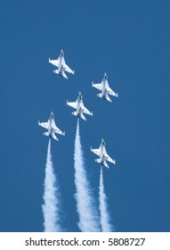 Five US Air Force Thunderbirds flying in formation