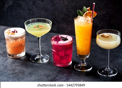 Five variously colored cocktails teasing the drinker and flirting around