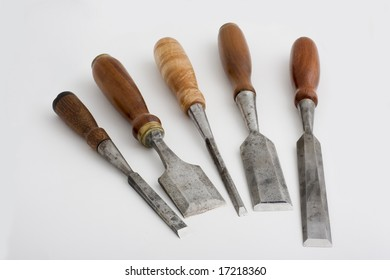 five vintage chisels with shop made turned hardwood handles
