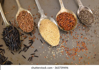 Five vintage silver spoons with healthy gluten free alternative seeds and grains