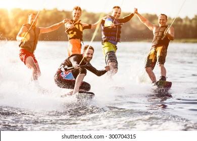 Five wake bord riders are having the fun