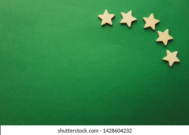five white stars on a green background