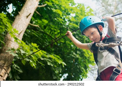 Five year boy on rope-way in the forest