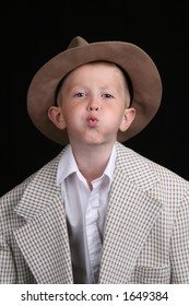 five year old boy playing dress-up, blowing a kiss