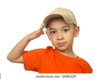 Five year old boy saluting, isolated on white