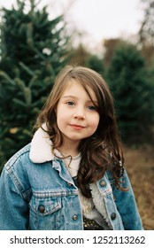Five year old girl dressed for a fun outing in a winter or fall lifestyle portrait featuring the young kid in an image from a film scan.