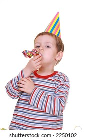 five years boy with noisemaker isolated on white